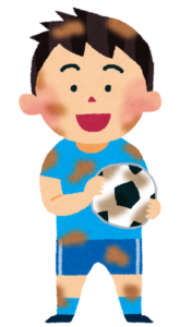泥だらけのサッカー少年